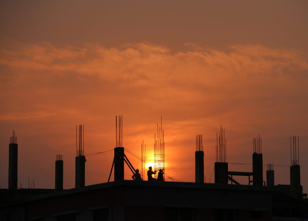 silhouette-of-men-in-construction-site-during-sunset-176342 (1)